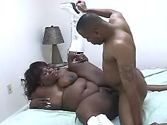 Ebony squeezing cock by huge boobs